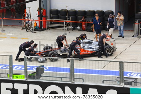 SEPANG, MALAYSIA - APRIL 8: Jenson Button (team Vodafone McLaren Mercedes) on the pit at first practice on Formula 1 GP, April 8 2011, Sepang, Malaysia - stock photo
