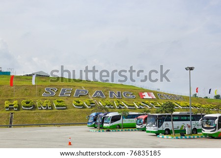 SEPANG, MALAYSIA - APRIL 10: Passenger buses wait for passengers at racing track of Formula 1, GP Malaysia, Sepang, April 10, 2011 in Sepang, Malaysia. - stock photo