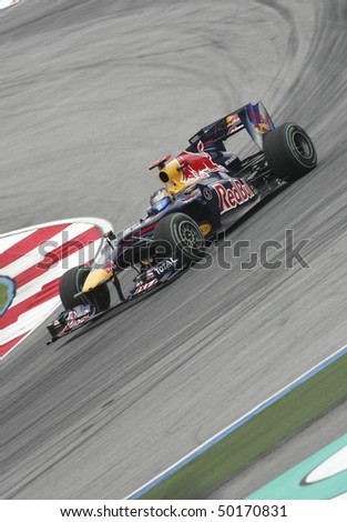 SEPANG, MALAYSIA - APRIL 2 : Red Bull Racing driver Sebastian Vettel of Germany drives during Petronas Malaysian Grand Prix second practice session at Sepang F1 circuit April 2, 2010 in Sepang - stock photo
