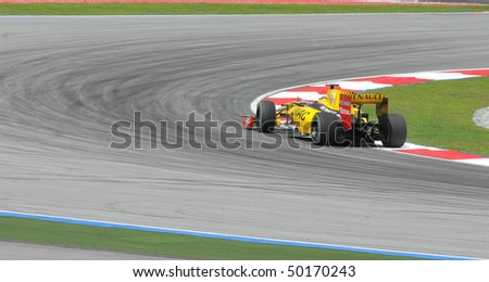 SEPANG, MALAYSIA - APRIL 2 : Renault F1 driver Robert Kubica of Poland drives during Petronas Malaysian Grand Prix second practice session at Sepang F1 circuit April 2, 2010 in Sepang - stock photo
