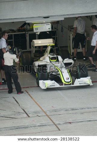 SEPANG, MALAYSIA - APRIL 3 : Rubens Barrichello of Brawn GP F1 Team exits pit garage during practice session at Malaysian F1 Grand Prix April 3, 2009 at Sepang International Circuit in Sepang.