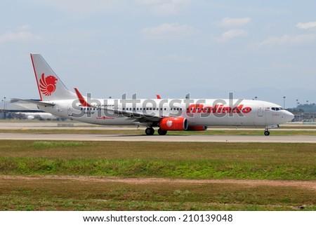 SEPANG, MALAYSIA - AUGUST 5: Malindo Air plane Boeing 737-900ER, Registration name 9M-LNF, take-off at KLIA airport on August 5, 2014 in KLIA, Sepang, Malaysia.  - stock photo