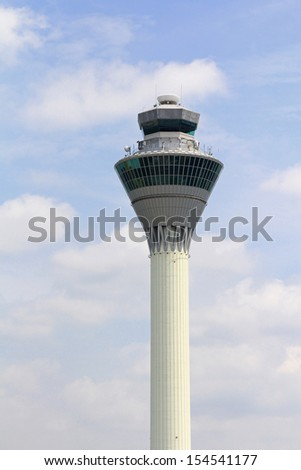 SEPANG, MALAYSIA - AUGUST 2013 : The closeup view of KLIA (Kuala Lumpur International Airport ) airport traffic control tower on blue sky on August 12, 2013 in Sepang district of Selangor, Malaysia.