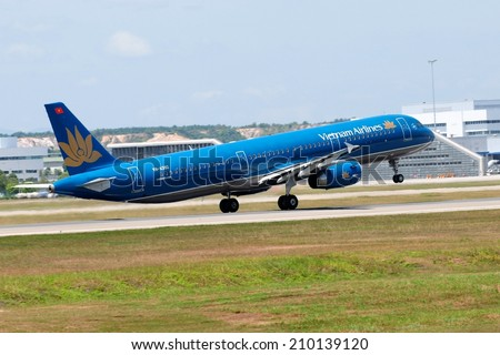 SEPANG, MALAYSIA - AUGUST 5: Vietnam Airline plane Airbus A321-231, Registration name VN-A392, take-off at KLIA airport on August 5, 2014 in KLIA, Sepang, Malaysia.  - stock photo