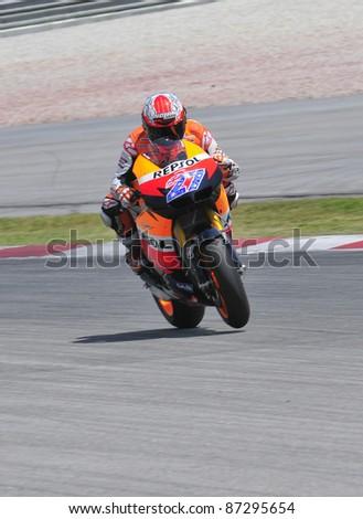SEPANG, MALAYSIA-FEB 24: Casey Stoner of Repsol Honda Team at MotoGP Official Test Sepang 2 on Feb 24, 2011 in Sepang, Malaysia. - stock photo