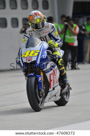 SEPANG, MALAYSIA - FEB. 26 : Fiat Yamaha Team rider Valentino Rossi of Italy exits the pit during the 2010 pre-season test at Sepang circuit February 26, 2010 in Sepang, Malaysia.