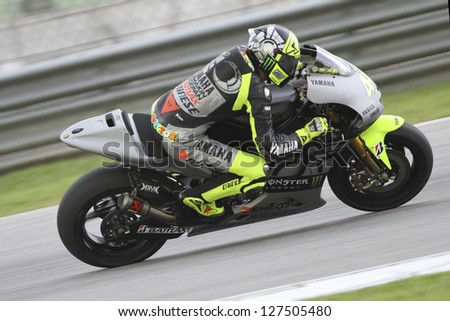 SEPANG, MALAYSIA-FEB 7: Italy No. 46 Valentino Rossi of Yamaha Factory Racing at MotoGP Official Test Sepang 1 on Feb 7, 2013 in Sepang, Malaysia. Season 2013 will start in Qatar on April 7. - stock photo