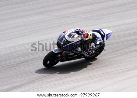 SEPANG, MALAYSIA - FEB 24 : Jorge Lorenzo of Yamaha Factory Racing takes a lap at MotoGP Official Test Sepang 2 on February 24, 2011 in Sepang, Malaysia. - stock photo