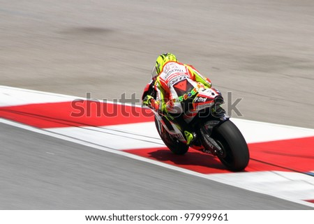 SEPANG, MALAYSIA - FEB 24: Valentino Rossi of Ducati Marlboro Team at MotoGP Official Test Sepang 2 on February 24, 2011 in Sepang, Malaysia. - stock photo
