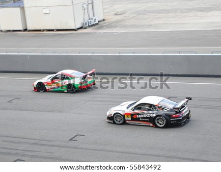 SEPANG, MALAYSIA - JUNE 20 : Super GT drivers in battle for position during the Super GT International Series, Round 4 on June 20, 2010 in Sepang International Circuit, Malaysia. - stock photo