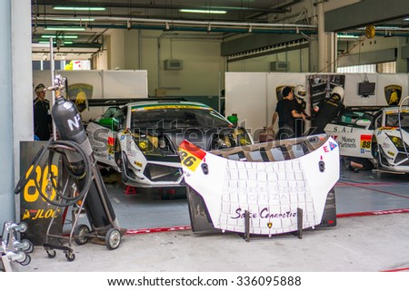 SEPANG, MALAYSIA - JUNE 2016 - Super GT race cars being prepared in the pit garage prior to raceday taken in Sepang International Circuit on 16 June 2013.