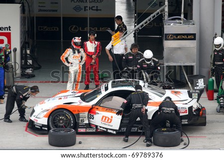 SEPANG, MALAYSIA - JUNE 21: The MJ Kraft SC430 (35) at the pit garage during the Super GT International Series Round 4 race. June 21, 2010 in Sepang Malaysia. - stock photo