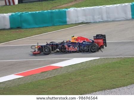 SEPANG, MALAYSIA - MARCH 23: Australian Mark Webber of Red Bull Racing-Renault in action during Friday practice at Petronas Formula 1 Grand Prix on March 23, 2012 in Sepang, Malaysia - stock photo