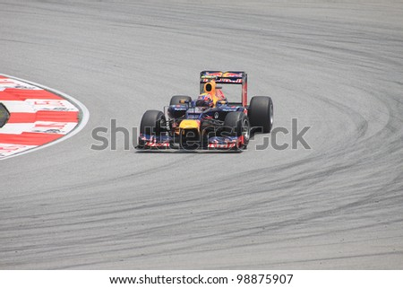 SEPANG, MALAYSIA - MARCH 23: Australian Mark Webber of Red Bull Racing-Renault in action during Friday practice at Petronas Formula 1 Grand Prix on March 23, 2012 in Sepang, Malaysia