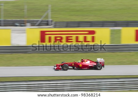 SEPANG, MALAYSIA - MARCH 23: Brazilian Felipe Massa of Team Scuderia Ferrari enters the pitlane road during Friday practice at Petronas Formula 1 Grand Prix March 23, 2012 in Sepang, Malaysia - stock photo