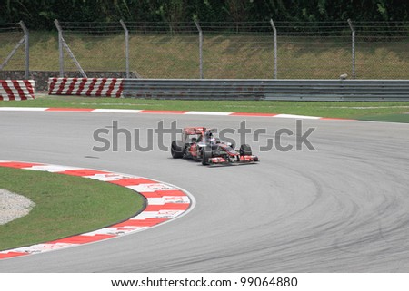 SEPANG, MALAYSIA - MARCH 23: British Jenson Button of McLaren-Mercedes in action during Friday practice at Petronas Formula 1 Grand Prix on March 23, 2012 in Sepang, Malaysia