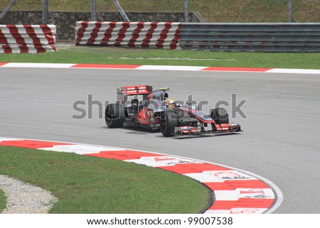 SEPANG, MALAYSIA - MARCH 23: British Lewis Hamilton of McLaren-Mercedes in action during Friday practice at Petronas Formula 1 Grand Prix on March 23, 2012 in Sepang, Malaysia - stock photo