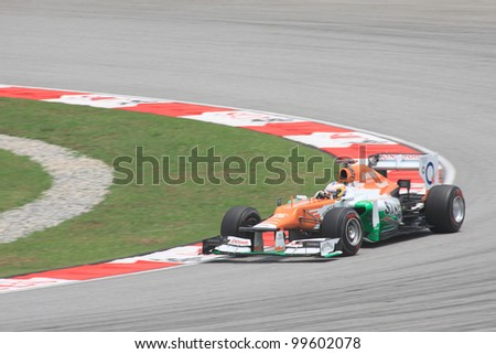 SEPANG, MALAYSIA - MARCH 23: British Paul di Resta of Force India-Mercedes in action during Friday practice at Petronas Formula 1 Grand Prix on March 23, 2012 in Sepang, Malaysia