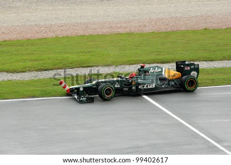 SEPANG, MALAYSIA - MARCH 25: Caterham-Renault Team driver Heikki Kovalainen hit the circuit stacker cone during race day of F1 Petronas Malaysian Grand Prix on March 25, 2012 in Sepang, Malaysia