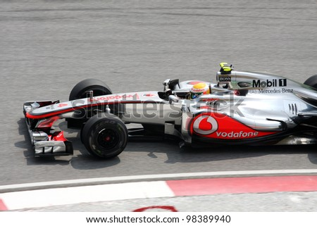 SEPANG, MALAYSIA - MARCH 23: Close -up Lewis Hamilton of Vodafone McLaren Mercedes in action during PETRONAS Malaysian Grand Prix practice session at Sepang F1 circuit on 23 March, 2012 in Sepang. - stock photo