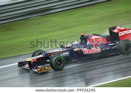SEPANG,MALAYSIA - MARCH 25: Daniel Ricciardo of Toro Rosso in action in rain-hit Formula One PETRONAS Malaysian Grand Prix at Sepang F1 Circuit on March 25,2012 in Sepang,Malaysia. Alonso won the race - stock photo