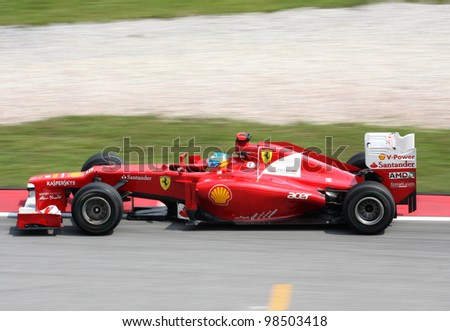 SEPANG, MALAYSIA - MARCH 23: Fernando Alonso of Scuderia Ferrari team in action during PETRONAS Malaysian Grand Prix practice session at Sepang F1 circuit  on 23 March, 2012 in Sepang, Malaysia. - stock photo