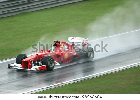 SEPANG,MALAYSIA-MARCH 25: Fernando Alonso of Scuderia Ferrari team in action in rain-hit Formula One PETRONAS Malaysian Grand Prix at Sepang F1 Circuit on March 25,2012 in Sepang, Malaysia. Alonso won. - stock photo