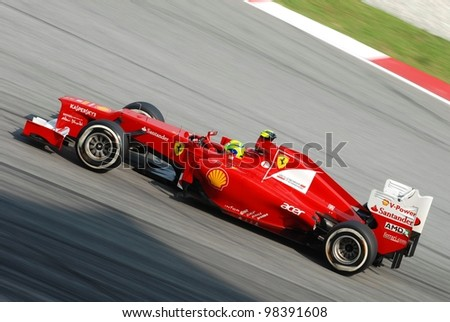 SEPANG, MALAYSIA - MARCH 24: Ferrari Team driver Felipe Massa action on track during Petronas Malaysian Grand Prix qualifying session at Sepang F1 circuit on March 24, 2012 in Sepang, Malaysia - stock photo