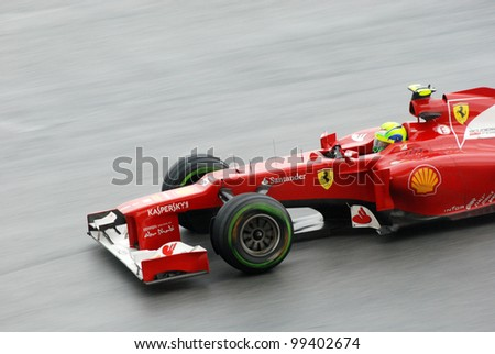 SEPANG, MALAYSIA - MARCH 25: Ferrari Team driver Felipe Massa action on track during race day of Petronas F1 Malaysian Grand Prix at Sepang Circuit on March 25, 2012 in Sepang, Malaysia - stock photo