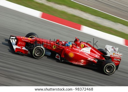 SEPANG, MALAYSIA - MARCH 24: Ferrari Team driver Fernando Alonso action on track during Petronas Malaysian Grand Prix qualifying session at Sepang F1 circuit on March 24, 2012 in Sepang, Malaysia - stock photo