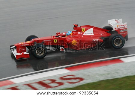 SEPANG, MALAYSIA - MARCH 25 : Ferrari Team driver Fernando Alonso of Spain in action during race day of F1 Petronas Malaysian Grand Prix at Sepang F1 circuit on March 25, 2012 in Sepang, Malaysia