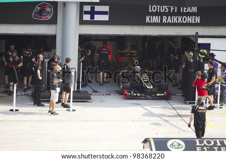 SEPANG, MALAYSIA - MARCH 23: Finnish Kimi Raikkonen of Team Lotus in his pit during Friday practice at Petronas Formula 1 Grand Prix March 23, 2012 in Sepang, Malaysia - stock photo