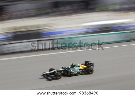 SEPANG, MALAYSIA - MARCH 23: Finnish Russian Vitaly Petrov down the main straight during Friday practice at Petronas Formula 1 Grand Prix March 23, 2012 in Sepang, Malaysia - stock photo