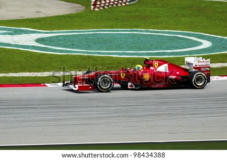 SEPANG, MALAYSIA-MARCH 23 : Formula One driver Felipe Massa of Scuderia Ferrari Team races during the first practice session on March 23, 2012 in Sepang International Circuit in Sepang, Malaysia.