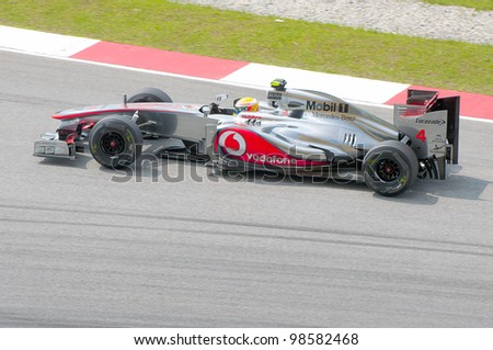 SEPANG, MALAYSIA-MARCH 23 : Formula One driver Lewis Hamilton of Mclaren Mercedes F1 team races during the first practice session on March 23, 2012 at Sepang International Circuit in Sepang, Malaysia.