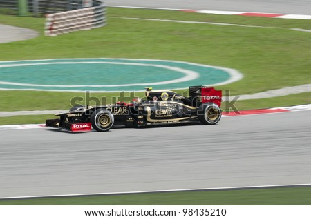 SEPANG, MALAYSIA-MARCH 23 : Formula One driver Romain Grosjean of Lotus F1 Team races during the first practice session on March 23, 2012 in Sepang International Circuit in Sepang, Malaysia. - stock photo