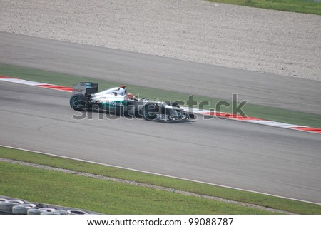 SEPANG, MALAYSIA - MARCH 23: German Michael Schumacher of Mercedes in action during Friday practice at Petronas Formula 1 Grand Prix on March 23, 2012 in Sepang, Malaysia