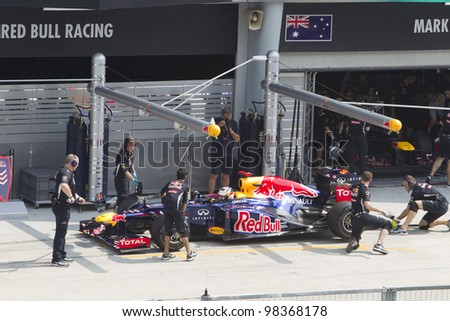 SEPANG, MALAYSIA - MARCH 23: German Sebastian Vettel of Team Red Bull does a trial pit stop during Friday practice at Petronas Formula 1 Grand Prix March 23, 2012 in Sepang, Malaysia - stock photo