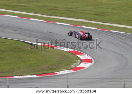 SEPANG, MALAYSIA - MARCH 23: German Sebastian Vettel of Team Red Bull exits turn 9 during Friday practice at Petronas Formula 1 Grand Prix March 23, 2012 in Sepang, Malaysia