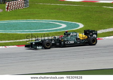 SEPANG, MALAYSIA - MARCH 23: Heikki Kovalainen (team Caterham Renault) at second practice on Formula 1 GP, March 23 2012, Sepang, Malaysia - stock photo