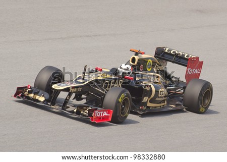 SEPANG, MALAYSIA - MARCH 23: Kimi Raikkonen  of Lotus F1 Team takes to the tracks on practice day of the Petronas Malaysian F1 Grand Prix on March 23, 2012 in Sepang, Malaysia. - stock photo
