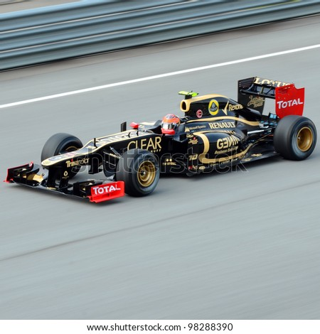 SEPANG, MALAYSIA - MARCH 23 : Lotus-Renault Team driver Romain Grosjean in action during Petronas Malaysian Grand Prix second practice session at Sepang F1 circuit March 23, 2012 in Sepang - stock photo