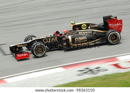 SEPANG, MALAYSIA - MARCH 24 : Lotus-Renault Team driver Romain Grosjean in action during Petronas F1 Malaysian Grand Prix third practice session at Sepang F1 circuit on March 24, 2012 in Sepang - stock photo