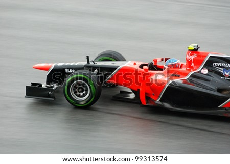 SEPANG, MALAYSIA - MARCH 25 : Marussia Team driver Charles Pic in action during race day of Petronas F1 Malaysian Grand Prix at Sepang Circuit on March 25, 2012 in Sepang, Malaysia - stock photo