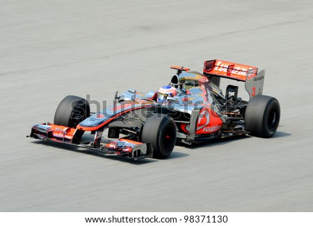 SEPANG, MALAYSIA-MARCH 23: McLaren-Mercedes driver Jenson Button action on track during Petronas Malaysian Grand Prix practice session at Sepang F1 circuit on March 23, 2012 in Sepang, Malaysia. - stock photo