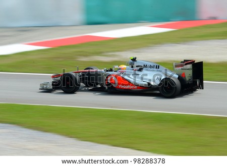 SEPANG, MALAYSIA - MARCH 23 : McLaren-Mercedes Team driver Lewis Hamilton in action during Petronas Malaysian Grand Prix second practice session at Sepang F1 circuit March 23, 2012 in Sepang - stock photo