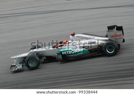 SEPANG, MALAYSIA - MARCH 25 : Mercedes Team driver Michael Schumacher on  track during race day of F1 Petronas Malaysian Grand Prix at Sepang F1 circuit on March 25, 2012 in Sepang, Malaysia - stock photo