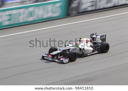 SEPANG, MALAYSIA - MARCH 23: Mexican Sergio Perez of team Sauber down the main straight during Friday practice at Petronas Formula 1 Grand Prix on March 23, 2012 in Sepang, Malaysia