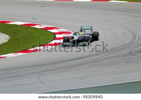 SEPANG, MALAYSIA - MARCH 23: Nico Rosberg (team Mercedes Petronas) at second practice on Formula 1 GP, March 23 2012, Sepang, Malaysia. - stock photo