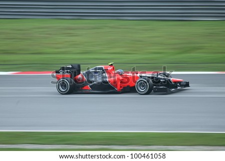 SEPANG, MALAYSIA - MARCH 25: Panning shot of Charles Pic from Marussia Team   during the race day of of F1 Petronas Malaysian Grand Prix at Sepang F1 circuit on March 25, 2012 in Sepang, Malaysia